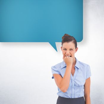 Furious businesswoman with speech bubble looking at the camera against white wall
