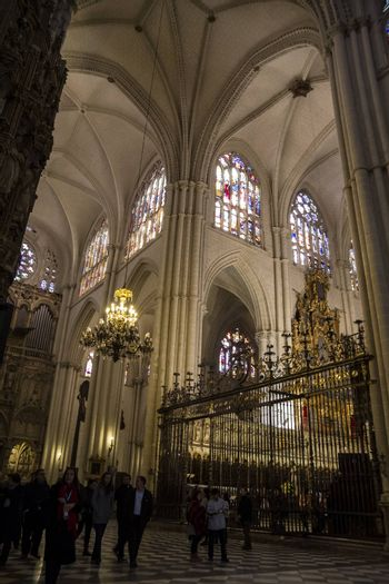 Interior of Toledo Cathedral. Arcs, organ, columns and gothic art. Spain