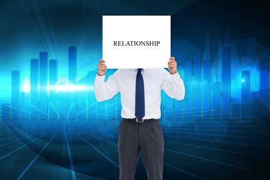 Businessman holding card saying relationship