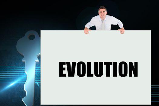 Businessman holding card saying evolution