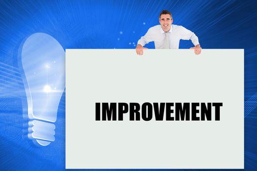 Businessman showing card saying improvement