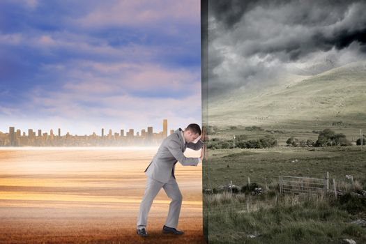 Composite image of businessman pushing away scene of stormy countryside background