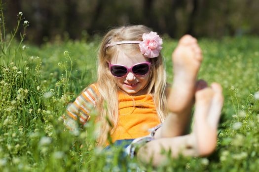 small barefooted girl in grass