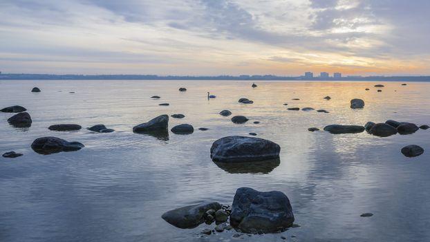 Beautiful sunrise on the sea. Views of Tallinn.