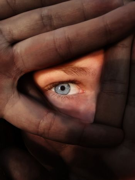 Eye looking through darkness
