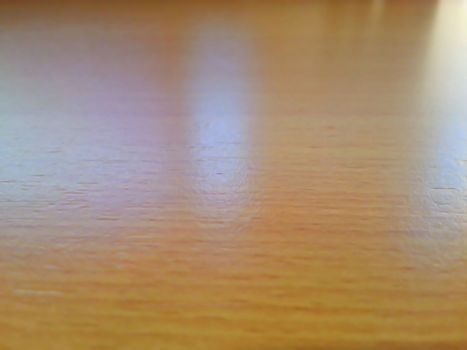 Wooden table texture in focus, blur