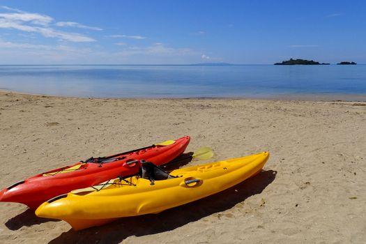 Colorful kayaks on a beach, Vanua Levu island, Fiji