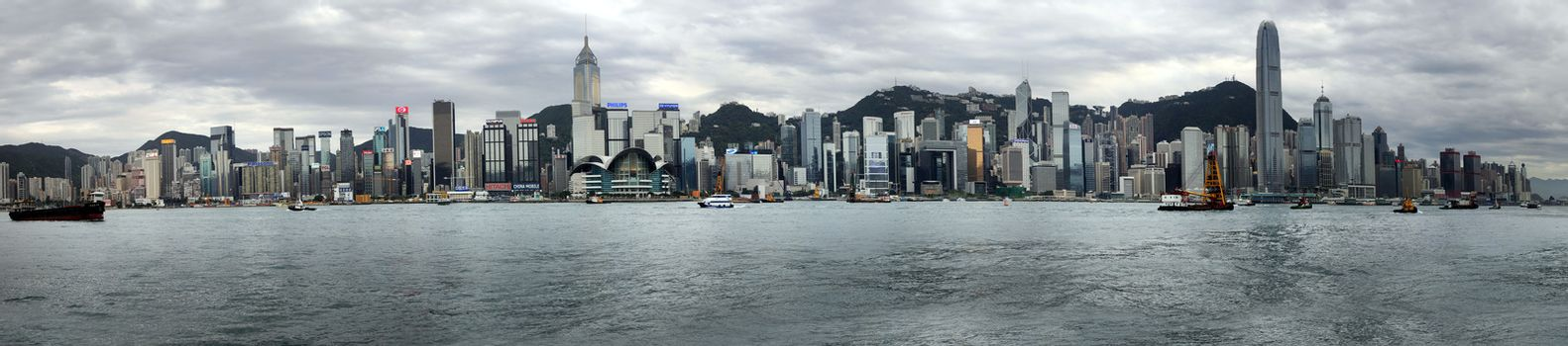 HONG KONG - APRIL 26:  Panorama of 10 frames. View of modern skyscrapers in downtown Hong Kong on sunset, China on April 26, 2014.