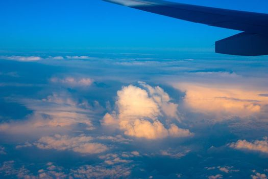 Top view of clouds under airplane wing