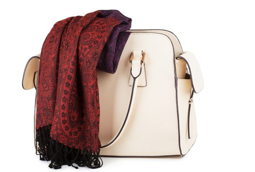 White female handbag with red scarf over white background
