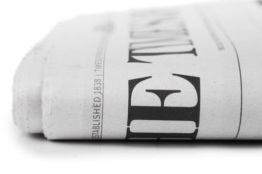 Closeup view of folded newpaper over white background