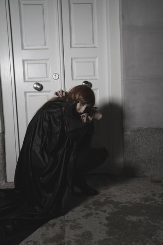 Vampire, Dark beauty under rain, red hair woman with long black coat