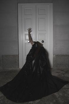 Call, Dark beauty under rain, red hair woman with long black coat