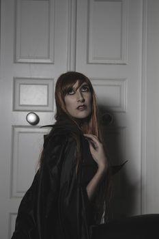 Sad, Dark beauty under rain, red hair woman with long black coat
