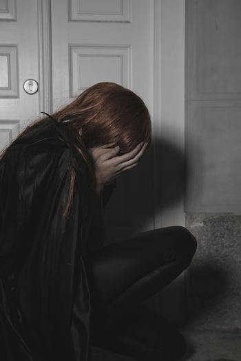 Cry, Dark beauty under rain, red hair woman with long black coat