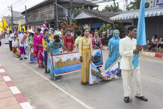 "THAILAND - OCTOBER 20: Unidentified people participated in ""Ngan Chak Pra"", a traditional buddhist festival on October 20, 2013 in Chaiya,Suratthani, Thailand."
