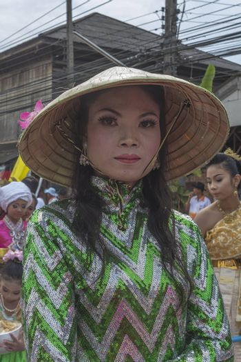 """THAILAND - OCTOBER 20: Unidentified woman participates in """"Ngan Chak Pra"""", a traditional buddhist festival on October 20, 2013 in Chaiya,Suratthani, Thailand."""