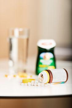 Vitamin pills on table
