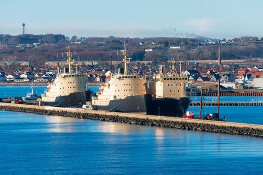 Three cargo ships docked in port