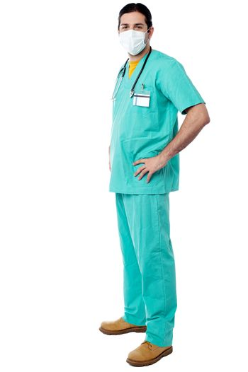 Experienced surgeon with hands on his waist