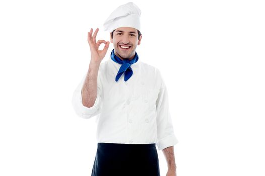 Smiling male chef showing ok hand sign