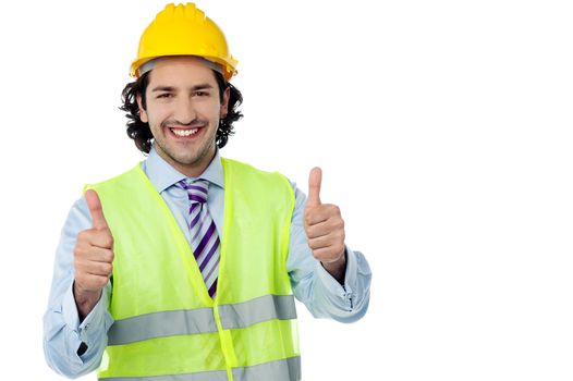 Successful engineer showing thumbs up