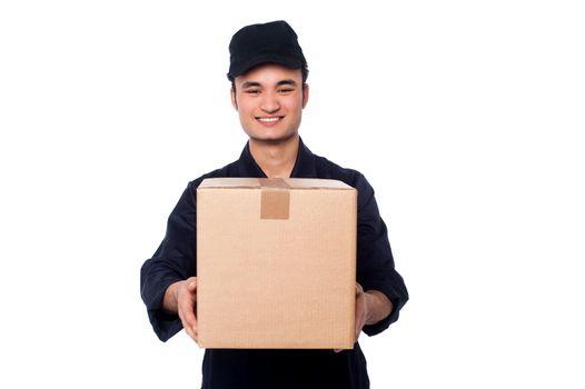 Young boy delivering parcel safely