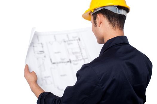 Engineer reviewing blueprint