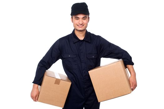 Young courier guy holding boxes