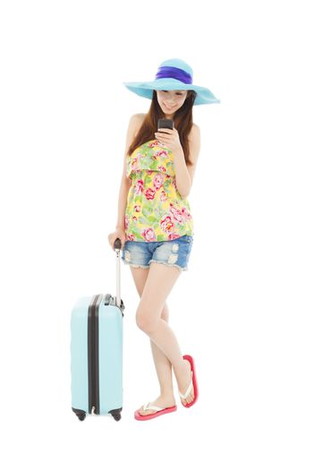young woman looking the smart phone with  travel baggage