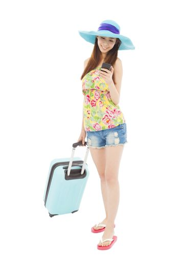 happy young woman looking the smart phone with baggage