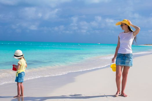 Young mother walking with her daughter during their carribean vacation