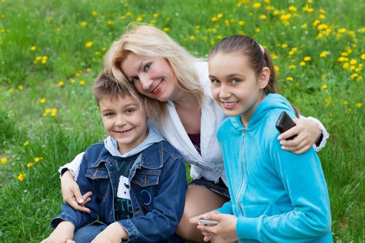 happy family of mother and two children
