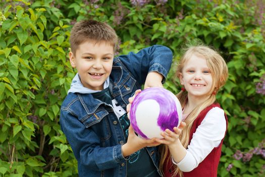 boy and girl with a ball