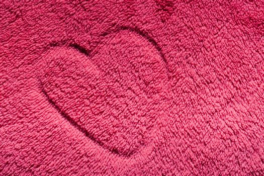 Heart on red furry cloth. Love, Valentine's Day background