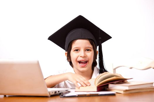 little boy in hat with computer and textbooks on white background