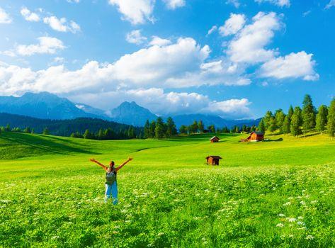Happy traveler in mountainous valley