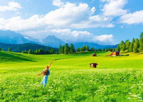 Happy traveler girl in mountainous valley