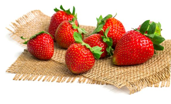 Strawberry over old burlap background