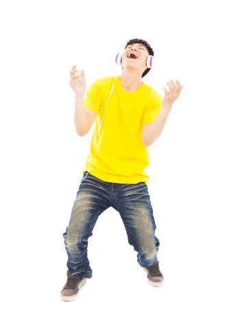 young man listening music and yelling out