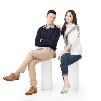 Portrait of young Asian couple sit