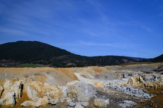 huge quarry with blue sky in spring