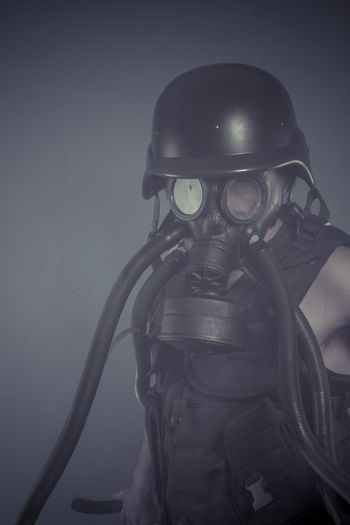 Radiation, Man with black gas mask, pollution concept and ecological disaster