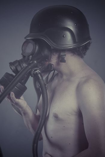 Man with black gas mask, pollution concept and ecological disaster