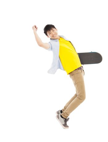Vibrant young man holding a skateboard