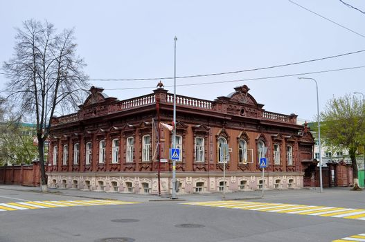 """""""Burkov's house"""" is a noticeable architectural and historical monument of Tyumen. Is on the former Sadovaya Street � nowadays to Dzerzhinsky Street. The house constructed by one of the richest people of Tyumen, the merchant of the first guild Vasily Petrovich Burkov is similar to the small palace. The decor of facades of the house unites in itself lines of stone and national wooden architecture. On a sample of stone mansions the front stairs and a main entrance are turned on the street. And here various types of carved platbands and other wooden elements of the building reflect specifics of a decor of wooden buildings.  In 1905 Burkov allocated the first floor of the house for placement of legal club """"Union of Workers of Tyumen"""". The millionaire and the shipowner Ivan Ignatov gave to club the richest library. In club passed discussion of the questions connected with professional affairs of workers, self-education and cultural life of the city. By 1906 the club became the real power, and ideas of the Bolshevism here began to get. For this reason club closed, and Bolsheviks went underground.  Address: Tyumen, Dzerzhinsky St., 30"""