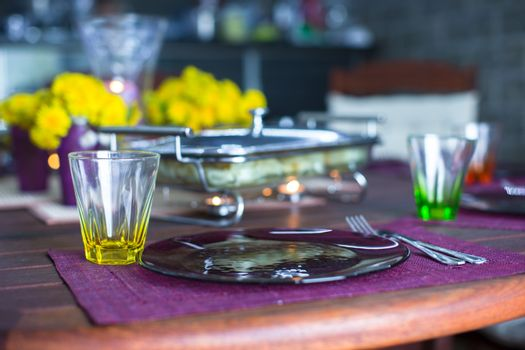 Closeup of beautiful color tableware for decorated table