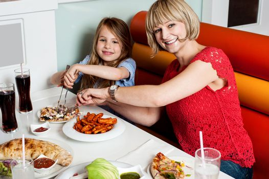 Daughter enjoying meal with her mother