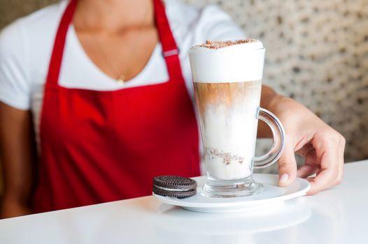 Female chef serving fresh milkshake