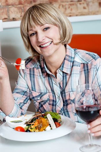 Middle aged woman eating healthy food